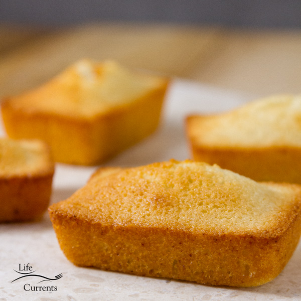 square image of four Financiers (French Almond Cakes)