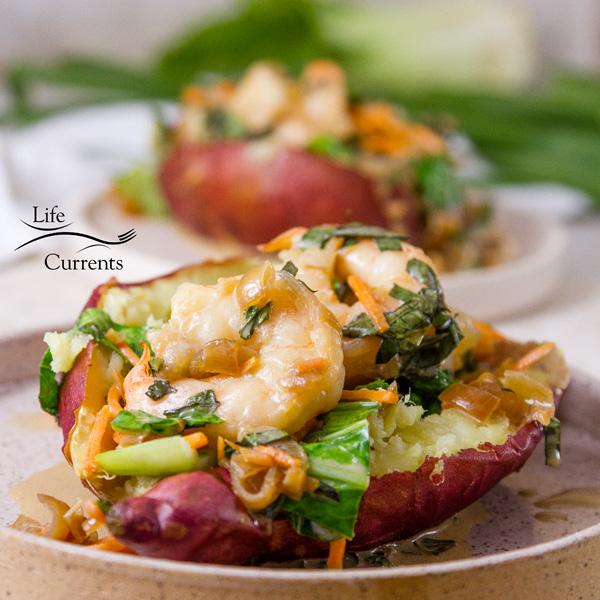 two servings of Thai Basil Shrimp stuffed in sweet potatoes