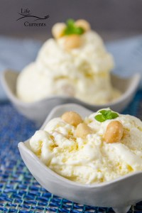 2 bowls of pineapple ice cream in white bowls on blue fabric