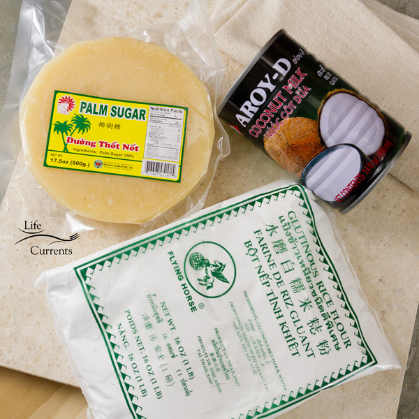 A package of palm sugar, a can of coconut milk, and a package of glutinous rice flour