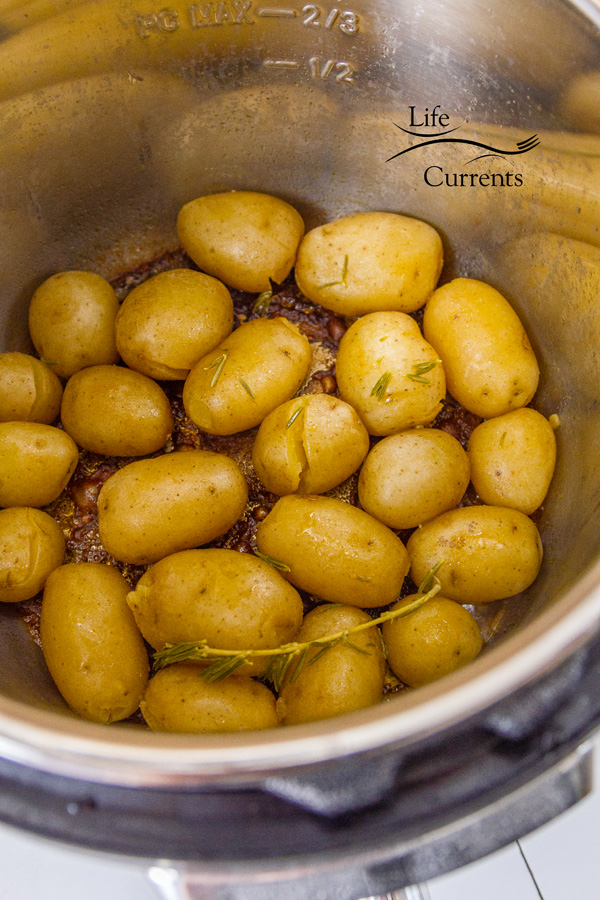 The potatoes during the saute mode. All of the broth has evopated and browned in the bottom of th epan.