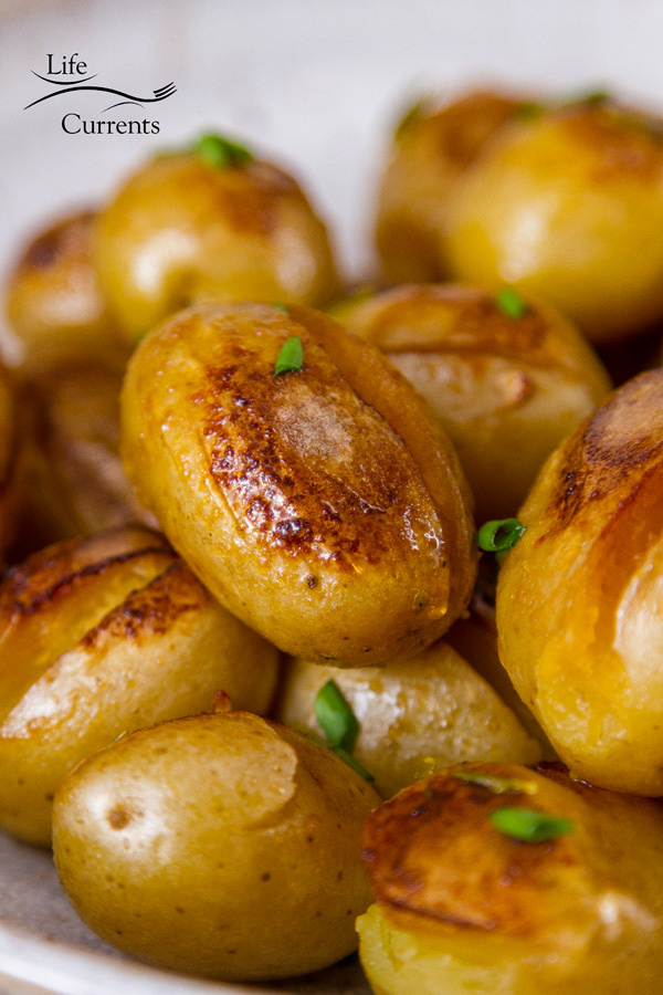 a close up of the browned edges of the cooked baby potatoes