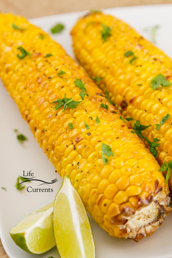 two ears of corn with lime wedges