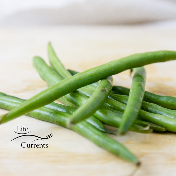 Fresh green beans, stacked up on top of eachother