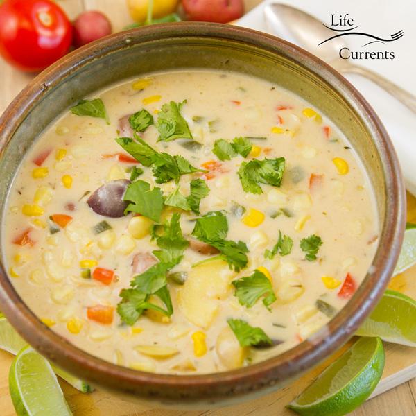 a bowl full of Southwestern Corn Chowder garnished with cilantro