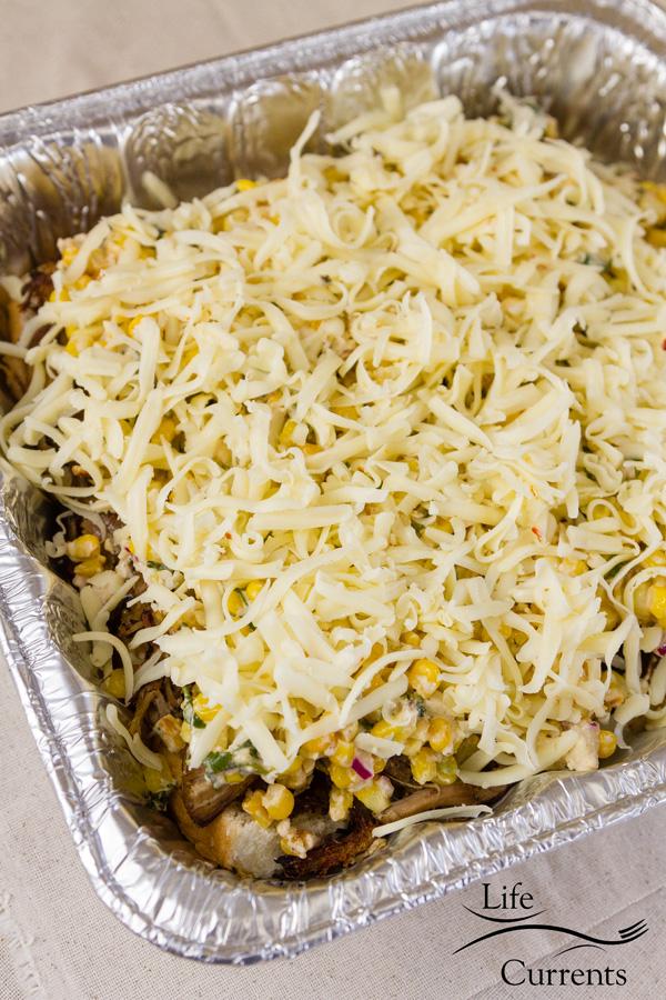 Carnitas Sliders: shredded pepperjack cheese comes next