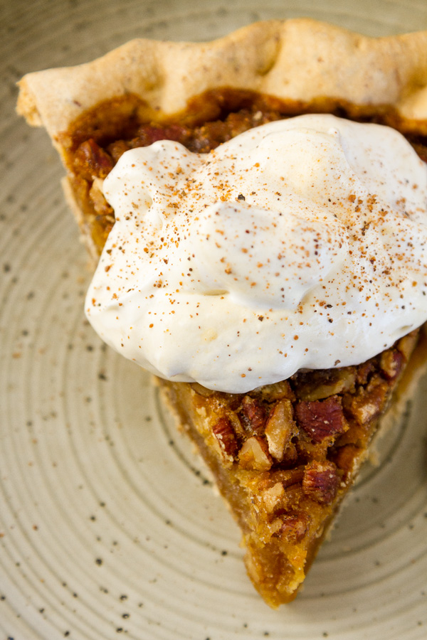 a piece of pecan pie with Peach Caramel Whipped Cream on top