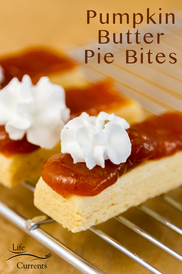 Shortbread cookies topped with pumpkin butter and whipped cream on a cooking rack with a title