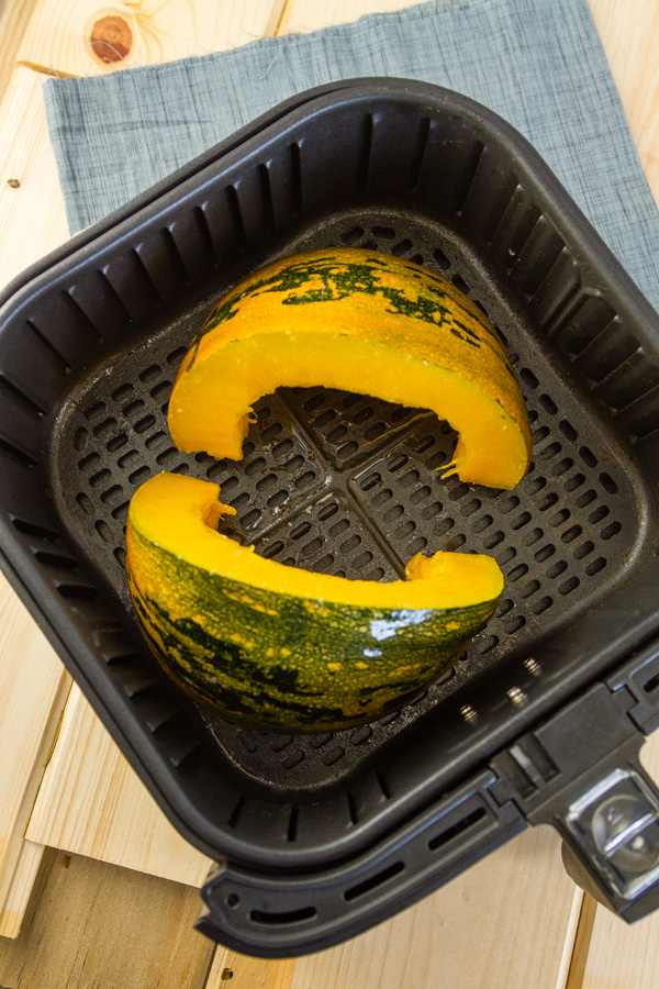 squash wedges in the basket of an air fryer