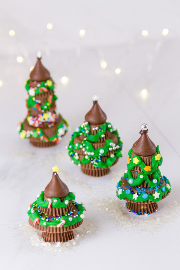 A forest of Peanut butter cup Christmas trees with twinkle lights