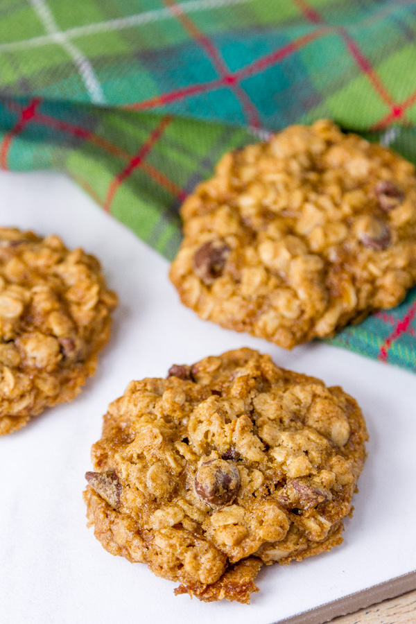 chocolate chip oatmeal cookies with a green and red napkin