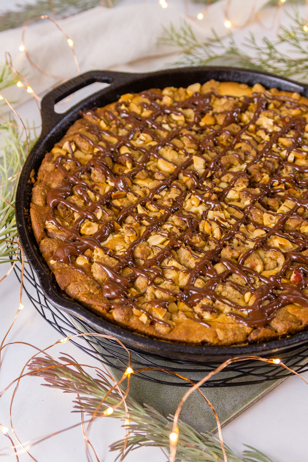 Peanut Butter Coffee Cake drizzled with chocolate in a cast iron skillet