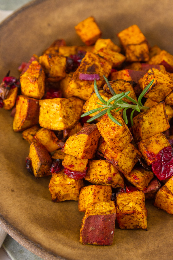 roasted sweet potatoes in a brown bowl