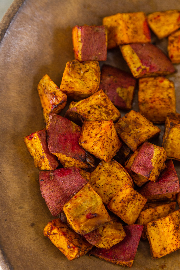 roasted cubed sweet potatoes in a brown bowl