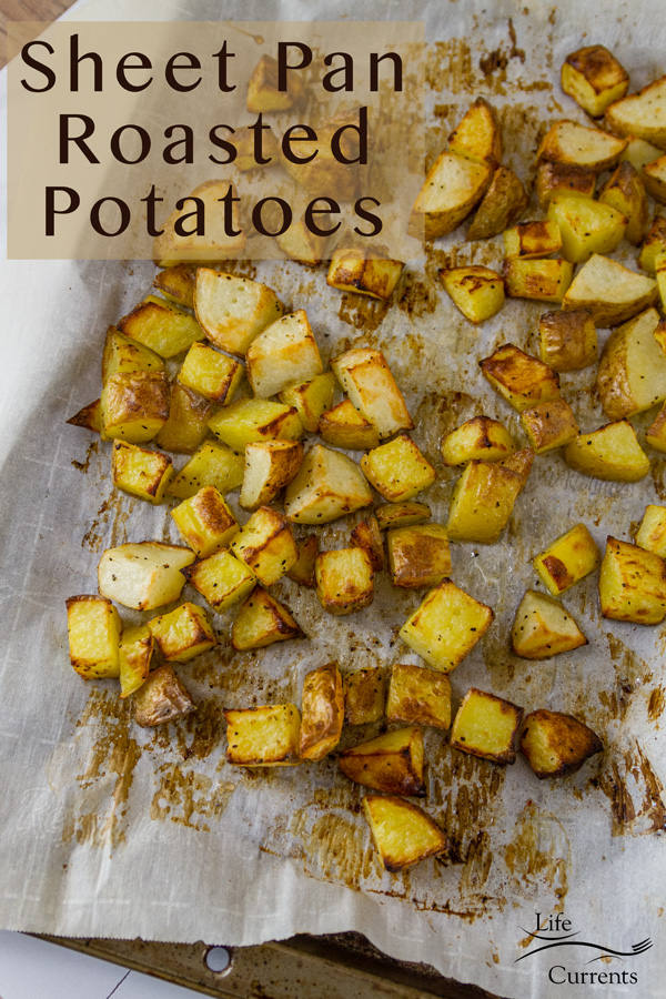 Sheet Pan Roasted Potatoes on parchment paper on a sheet pan with the title