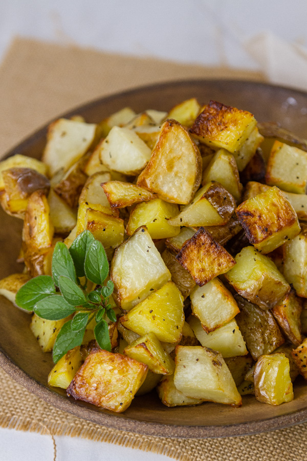 Sheet Pan Roasted Potatoes in a brown bowl for servings