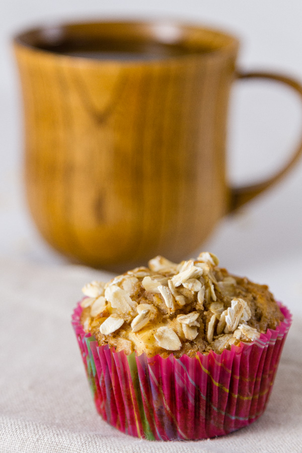 an apple oatmeal muffin with a cup of coffee is a great way to start the day