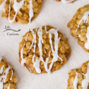 square crop of eggnog oatmeal cookies with icing on a napkin