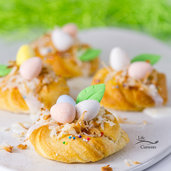 Easter Crescent Nests on a white plate with green Easter grass in the background