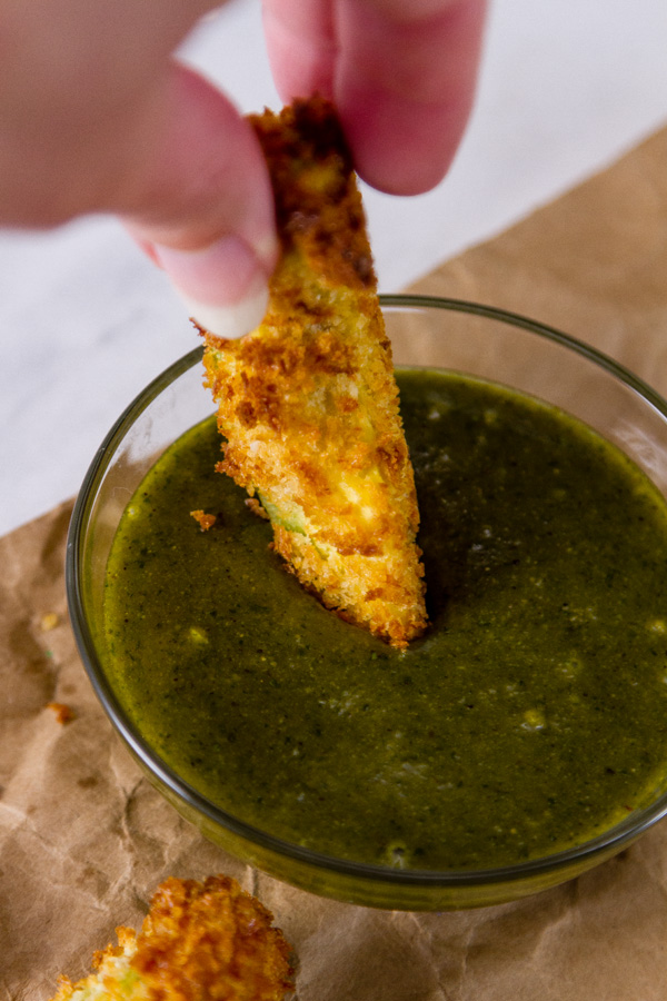 dipping an Air Fryer Avocado Fries with Cheesecake Factory Copycat Tamarind-Cashew Dipping Sauce