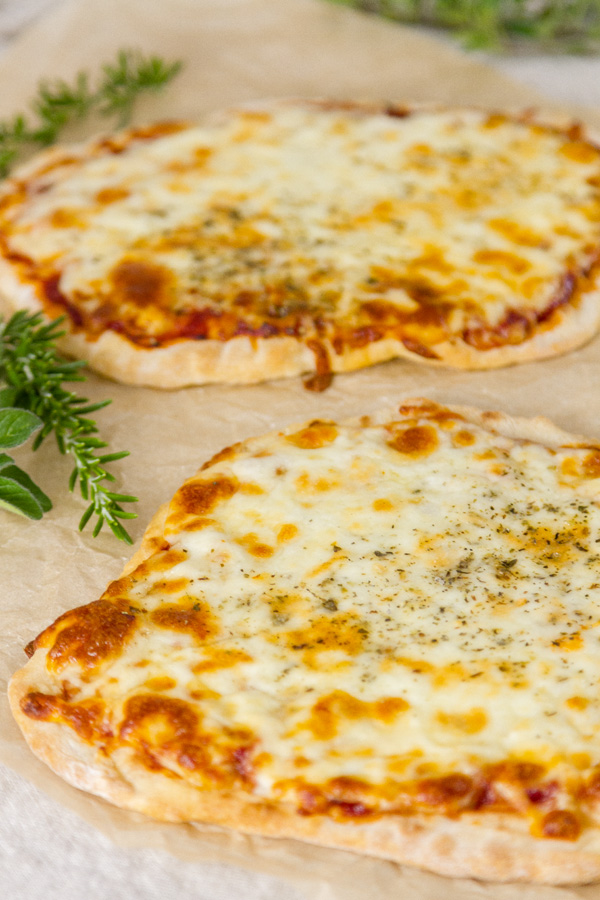 No yeast flatbreads made into pizzas - two of them - with some herbs around