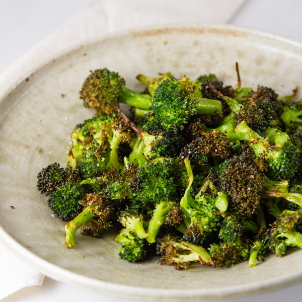 square crop of Air Fryer Roasted Broccoli in a white bowl