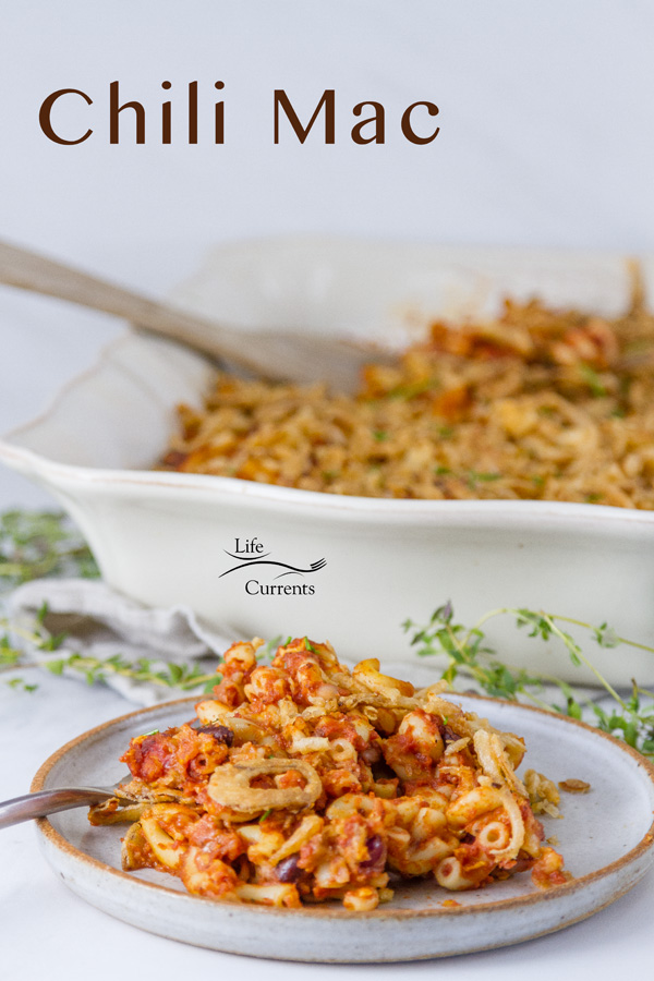 chili mac on a plate with a fork and the casserole in the background