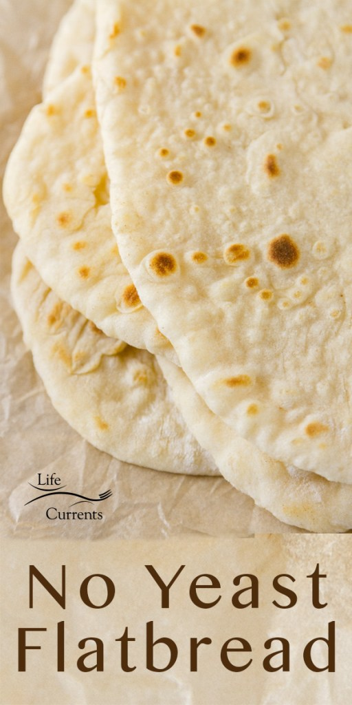 No yeast flatbread with the title and the image of the flatbreads stacked up on a piece of parchment paper, top down