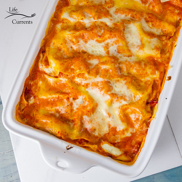 Sqare crop of Red Pepper Lasagna in a white pan