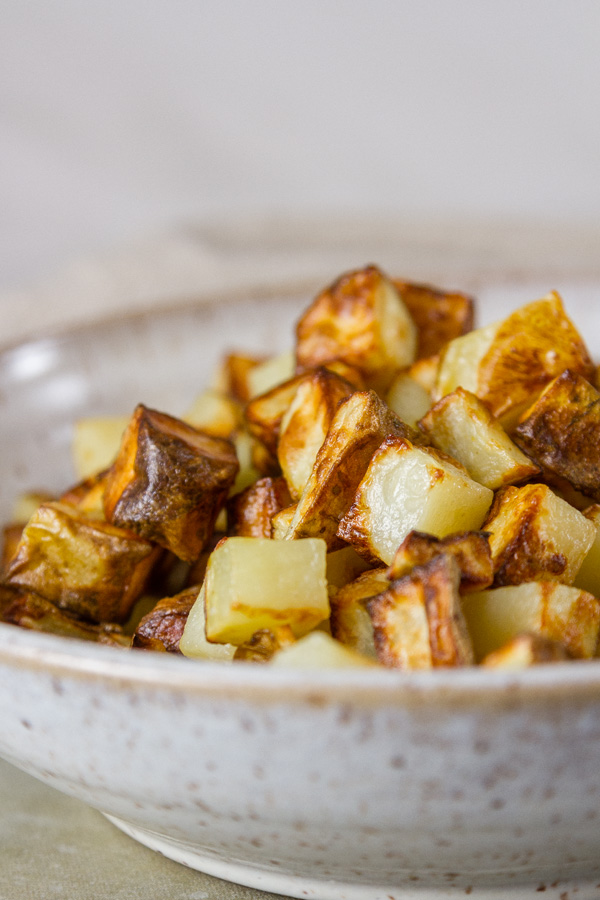 close up of Air Fryer Potatoes in a white bowl