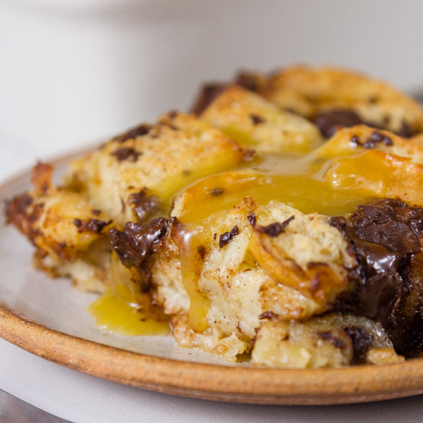 close up of Chocolate Bread Pudding with Bourbon Butter Sauce on a plate