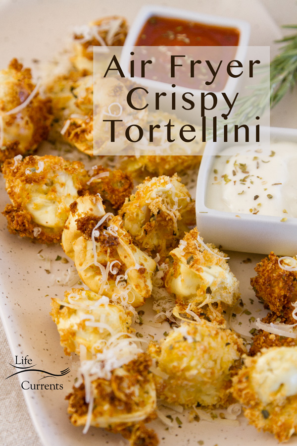 Air Fryer Crispy Tortellini with title sprinkled with Parmesan and served with marinara and Alfredo