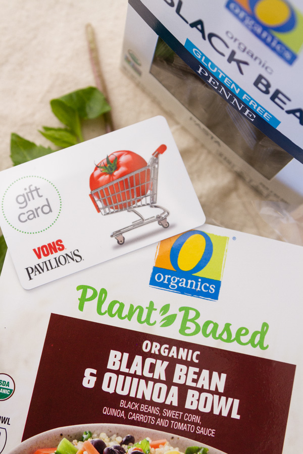 A gift card to Vons, a box of O Organics Black Bean pasta, and a box of O Organics Black bean and quinoa bowl