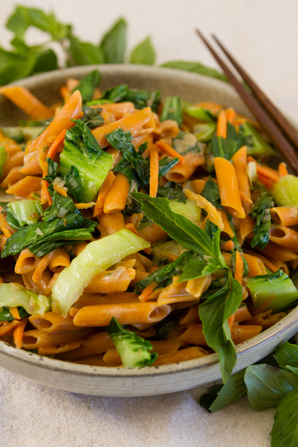 pasta and vegies in a bowl with chop sticks
