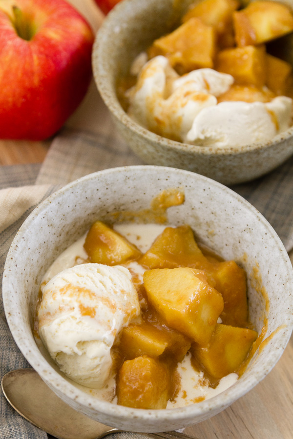 Slow Cooker {Crock Pot} Peanut Butter Caramel Apples in a bowl with ice cream
