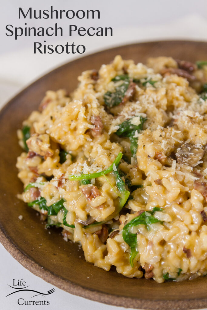 Mushroom Spinach Pecan Risotto in a brown serving dish with title and logo on image