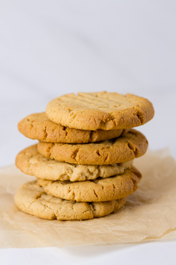 a stack of cookies on parchment paper