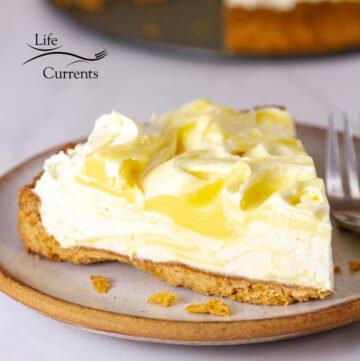 square crop of a slice of lemon cream pie.