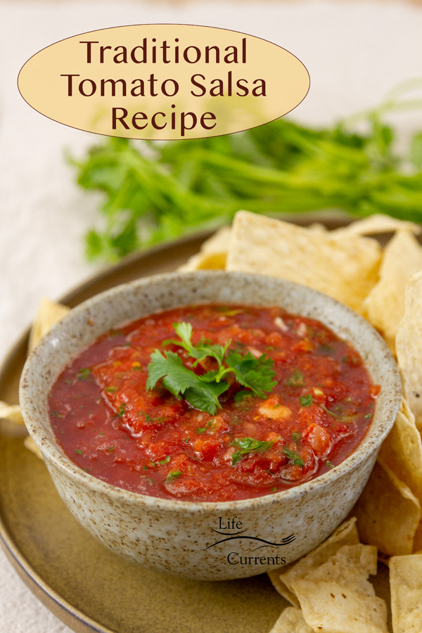 a bowl of tomato salsa topped with cilantro and served with chips, title on image: Traditional Salsa Recipe.