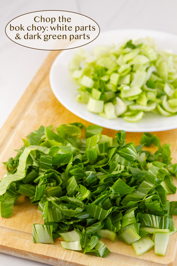 chopped bok choy in two piles, white parts and green parts.