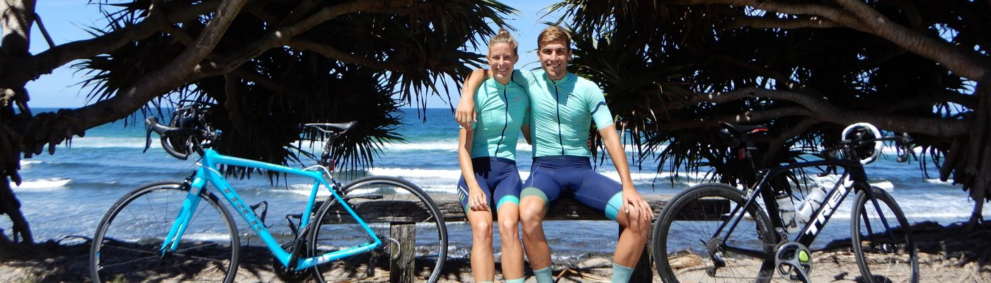 Your guides Chris Boogert and Alice Tancred sit with their bikes in Byron Bay, the home of their Cycling Holidays