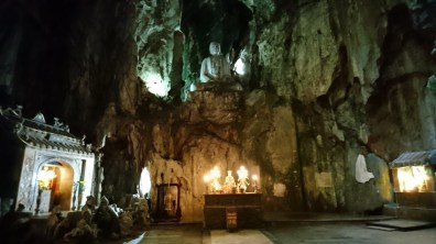 Giant Buddha statue inside the biggest cave of Marble Mountains
