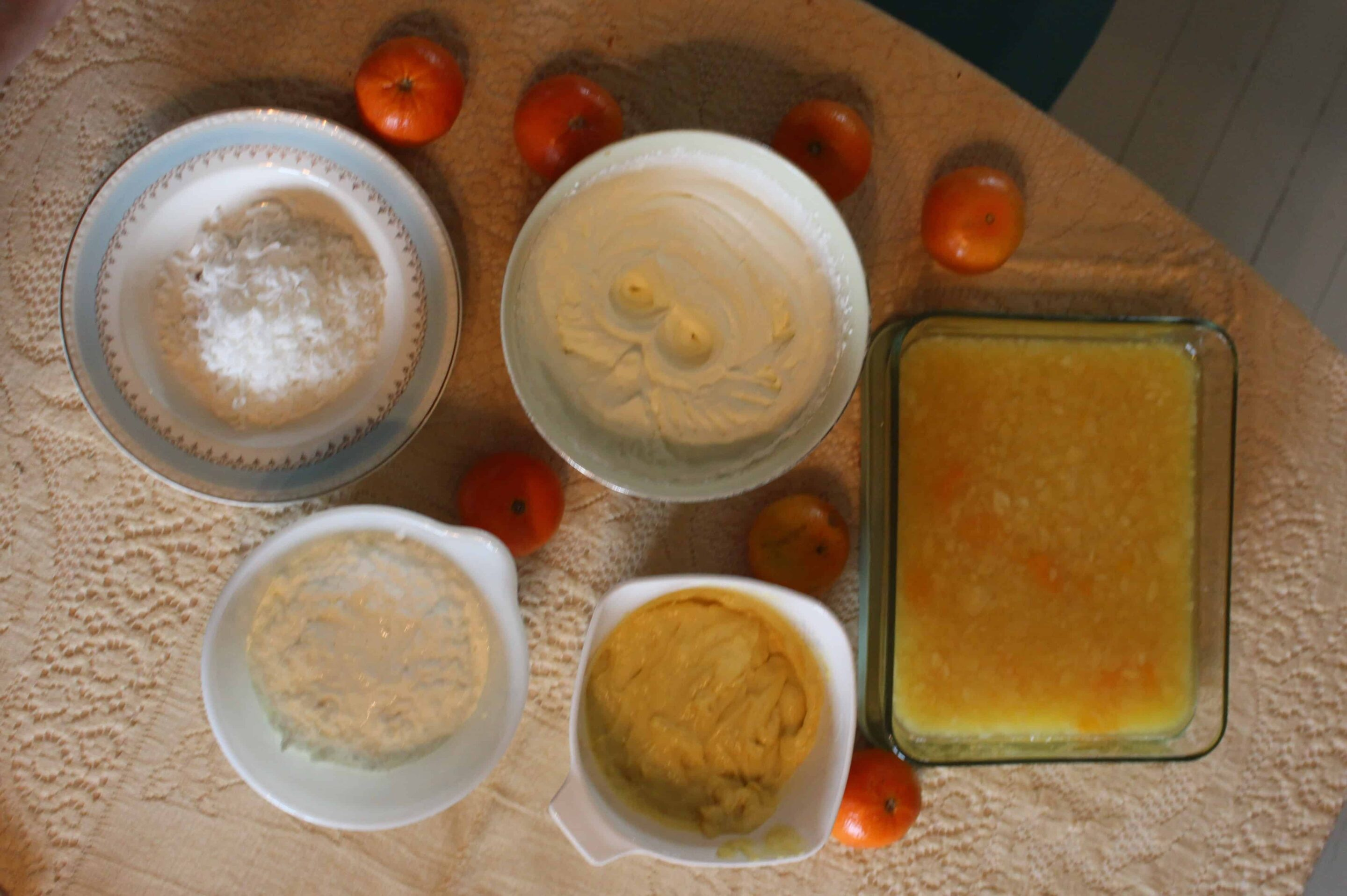 Top left: Coconut, Top middle: Whipped Cream, Far right: Pineapple Mandarin Orange Gelatin, Bottom middle: Pastry Cream, Bottom Left: Cottage Cheese