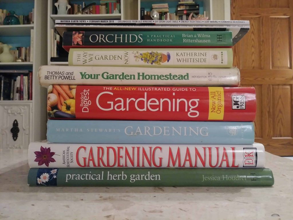 a stack of gardening books