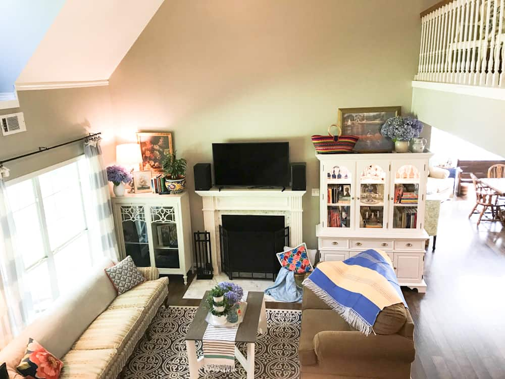 Life Full and Frugal Summer Living Room Makeover, view of living room with lots of colorful accents in the decor, decorative items from Mexico, coffee table, china cabinet, floral throw pillows and Mexican pottery