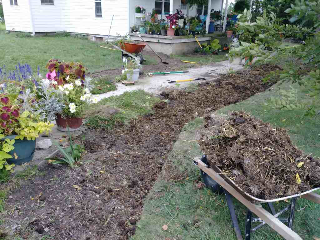 cutting in new flower beds and adding manure life full and frugal