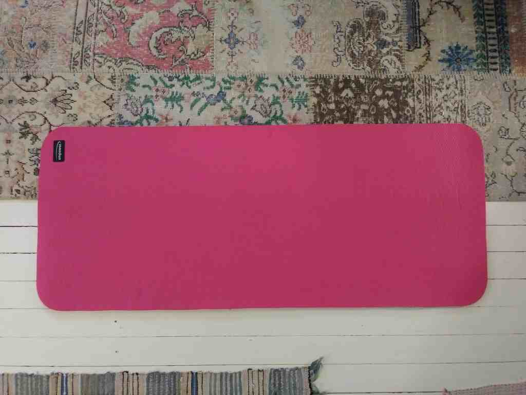 a pink yoga mat on the living room floor life full and frugal