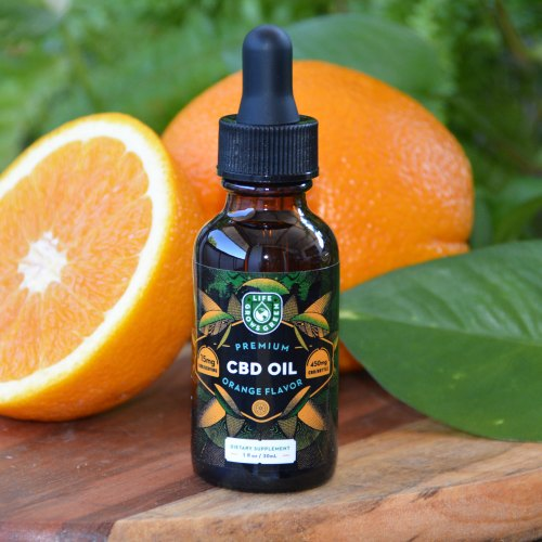 A bottle of 450mg CBD oil with orange flavor.