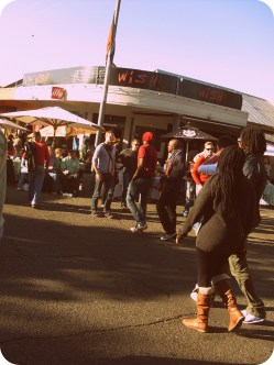 Festival goers strolled up and down the street listening to music coming out from the restaurants and bars