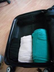 1: Place last bundles in suitcase